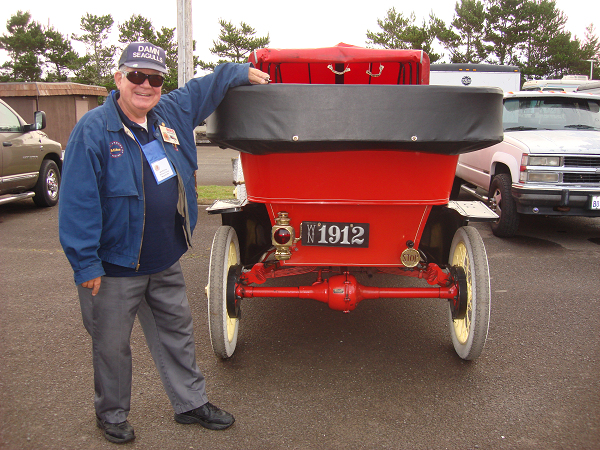 "Mike McGinnis proudly showing his 1912 Ford Model T, leather license plate and his ""Damn Seagulls"" cap. -- Mike & Donna McGinnis"